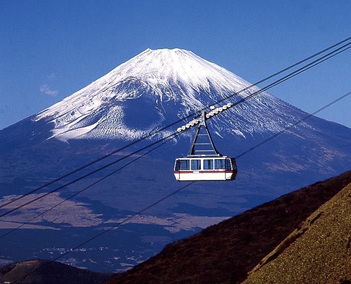 Climb aboard a Hakone Ropeway cable car and gaze down upon Mt. Fuji, Lake Ashi, Mt. Futago, volcanic peaks, steaming hot springs and shady valleys, Japan.