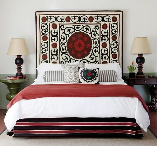 Ooh, what a great way to display a gorgeous textile!  I love that the bedlinen is streamlined and white but that the valence is colour-coordinated stripes!