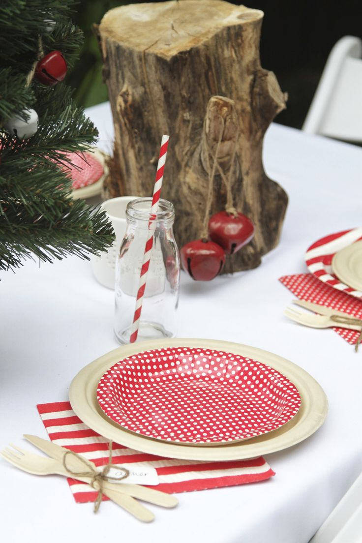 All Christmas and all disposable table setting! Get the look without all the cleanup using colourful red hiPP paper plates and napkins, bamboo plates, wooden cutlery and gorgeous paper straws | The Paper Lantern |