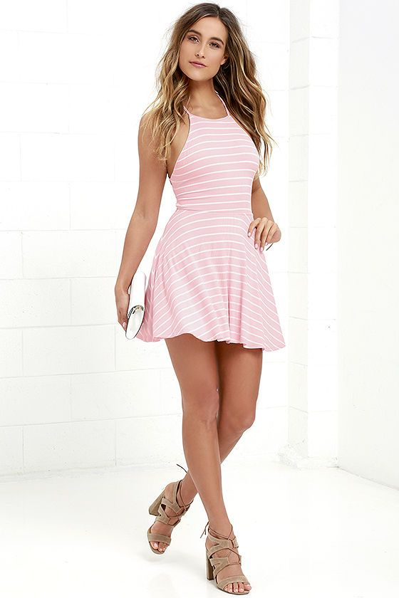 You'll be structured and stylish with the In Formation Pink Striped Lace-Up Dress! White and pink ribbed knit forms a cute skater dress with an apron neckline. Skinny straps lace-up and crisscross at back for a sexy finishing touch.