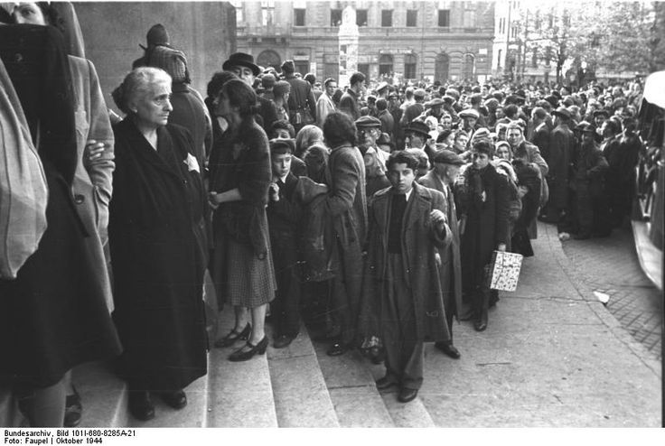 Budapest, Hungary, Oct 1944: Budapest Jews, rounded up by German troops and their Hungarian collaborators, crowd outside Budapest's State Theater, point of gathering the Jewish population for the trip to death camps. Statistically speaking, none of the Jews in this photo survived the one-way trip to their places of martyrdom.