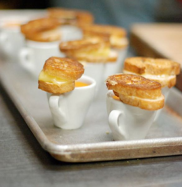 Mini grilled cheese sandwiches with tomato soup have become the yummiest little appetizers! Really, any mini sandwich with a spear would be devoured and appreciated. Just think; mini pastrami, mini ham and cheese, mini pulled pork, mini meat ball subs, or even mini pitas!