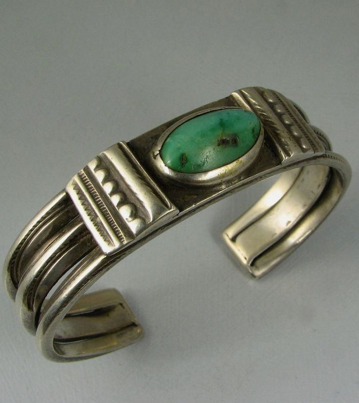 $240.50 A rare old Navajo handwrought stamped and chiseled ingot silver bracelet with an oval domed high bezel set green natural turquoise stone, with bracketing silver cross support panels, another bracelet I'm letting go from my personal collection.
