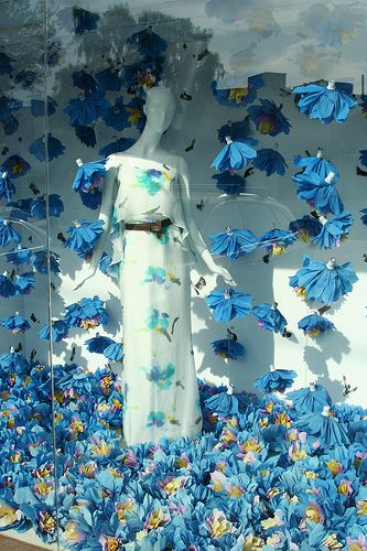 At first I thought these were repurposed latex gloves - but they're not but now I have that idea !!!! Blue flower window display