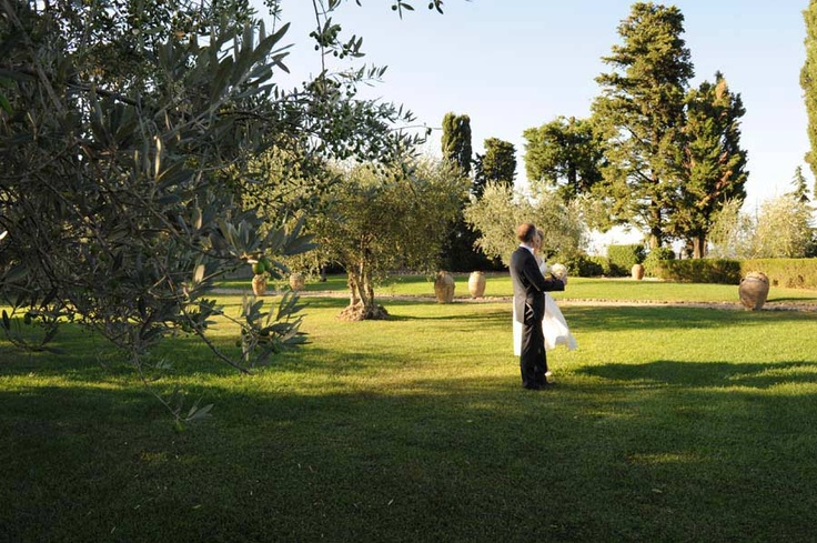 Wedding in Italy, Tuscany Castle - Bride and groom to enjoy the olive trees garden under the tuscan sunset