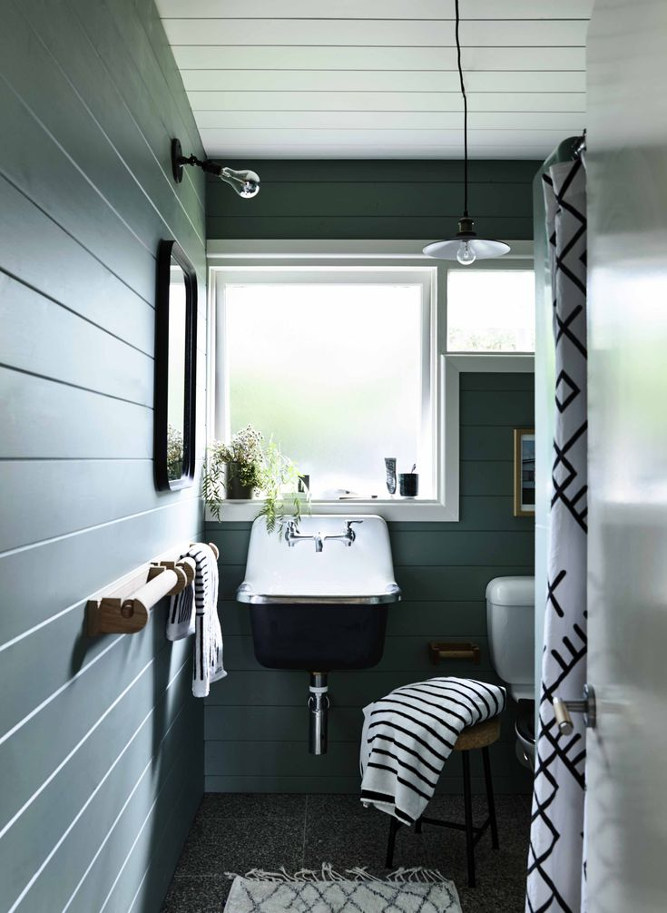 Phillip Island Beach Shack: We relined the bathroom walls with timber, replaced the bathroom basin and added interesting door hardware and towel rails. The bathroom is painted in Haymes Yucca, and the choice was helped along by an Instagram 'committee'. I would post images of the different shades of green I was considering, and get input from hundreds of people following along on the journey.