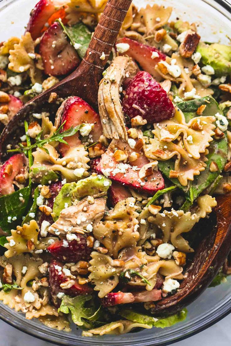 Strawberry Avocado Chicken Pasta Salad is loaded with spinach and arugula, strawberries, avocado, tender pasta noodles, chopped nuts, and a creamy balsamic dressing