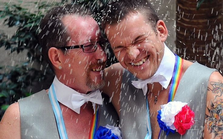 Russians Alexander Emereev (left) and Dmitry Zaytsev are showered in rice after their wedding in Buenos Aires. Alexander and Dmitry said they chose to wed in Argentina for fear of homophobia in their country. #lgbt #lgbtq
