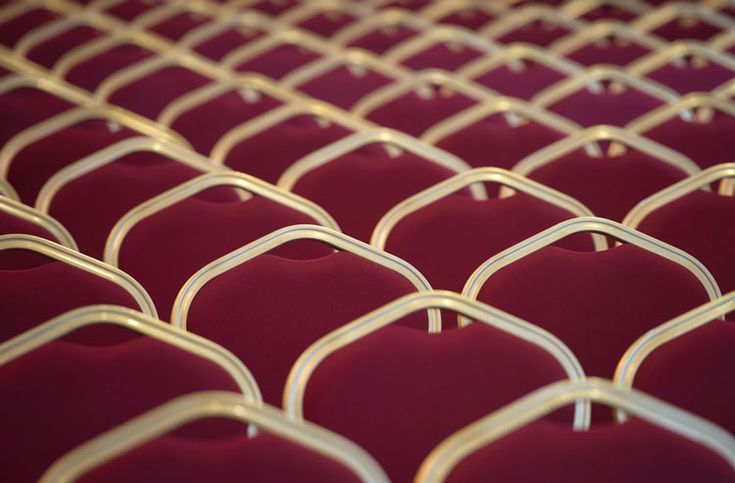 Close-up of red chairs in an empty room byDiana Matei Zaharia - Pantone 2015 Color of the Year: Marsala
