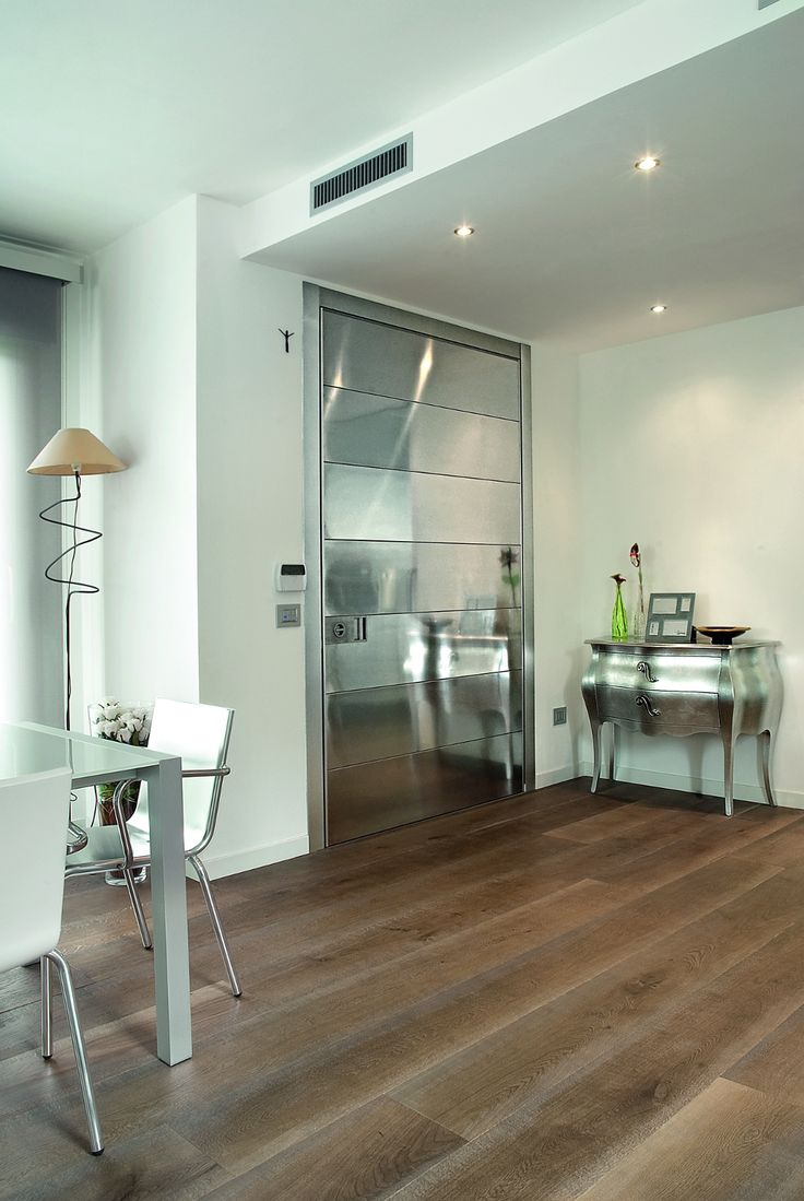 Stainless steel pivot modern door by Oikos Venezia