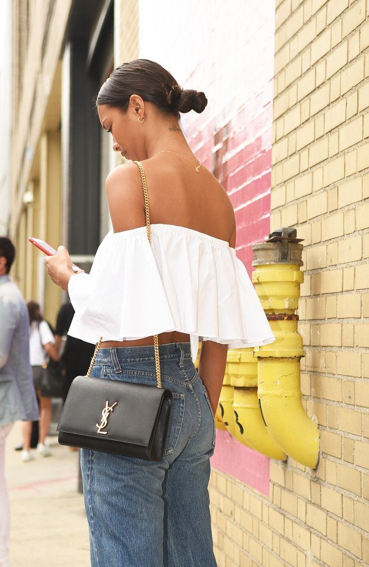 This look has all the elements of a winning summer outfit: high-waisted denim jeans (swoon), a YSL bag (double swoon), simple gold jewellery (note the necklace) and a fresh white off-the-shoulder top. Get into our wardrobe!