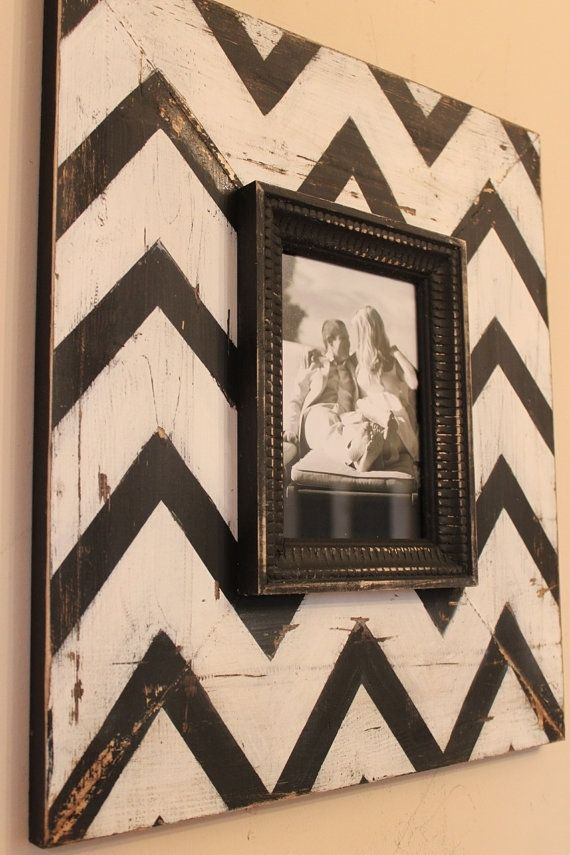 paint a piece of wood (could paint a solid color, or paint a design/pattern like this one), sand and distress/age the corners, then attach a regular picture frame on top.  These are about $150 in gift/home decor stores.Distressed Wood, Chevron Frames, Diy Crafts, Chevron Pattern, Painting Boards, Picture Frames, A Frames, Pictures Frames, Regular Pictures