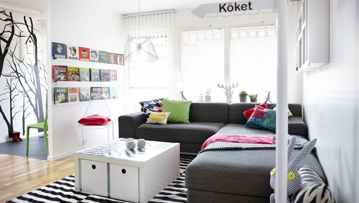 Compact living in Sweden. A beautiful small space with help from IKEA. You can get away with using all white if you have enough natural light and you can warm and anchor the room with a deep coloured sofa and brightly coloured accessories like the cushions they've used throughout this space. Believe it or not a child lives here too but their ingenious use of storage keeps her toys well hidden until she wants to play with them.