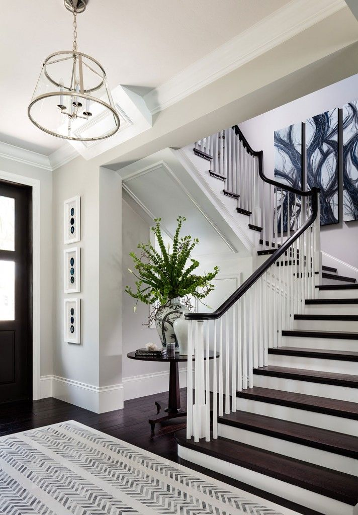 Foyer with dark hardwood floors and herringbone detail. Soft gray walls are Stonington Gray by Benjamin Moore.