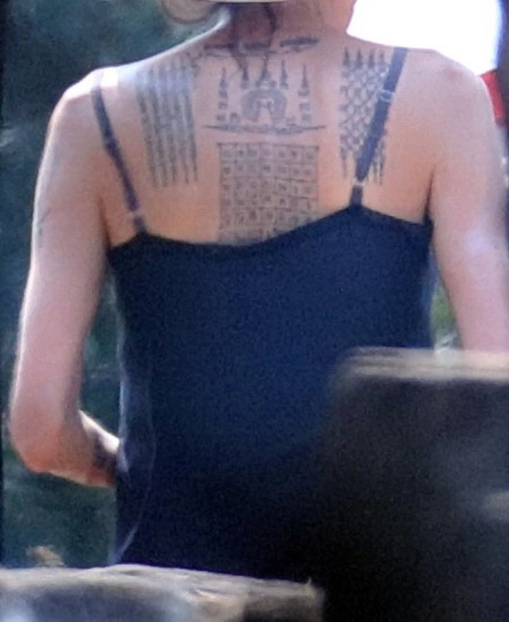 Angelina Jolie Debuts RADICAL Full Back Tattoo — Brad Gets Matching Ink - Houston Chronicle