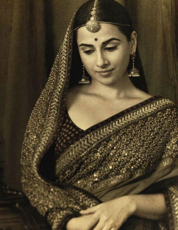 Vidya Balan plays a coy bride in an editorial for Vogue India magazine. She wear a quintessential earthy lehenga and sari