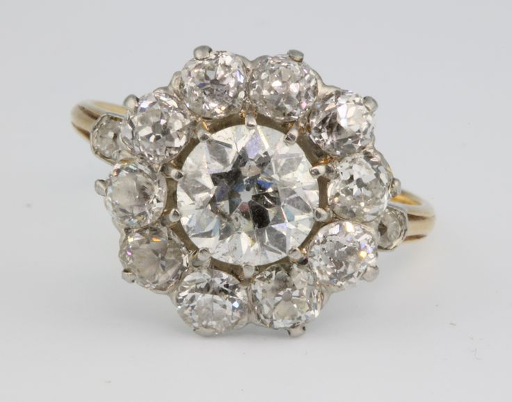 Lot 704, An 18ct yellow gold diamond cluster ring, the centre brilliant approx 1.5ct surrounded by 10 brilliants each 0.20ct with a brilliant to each shoulder, size O, sold for £2,450