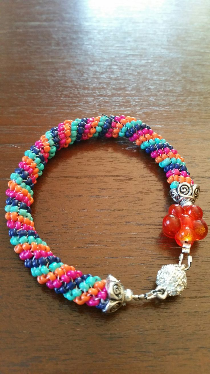 Tubular Peyote bracelet with orange accent bead and magnetic clasp
