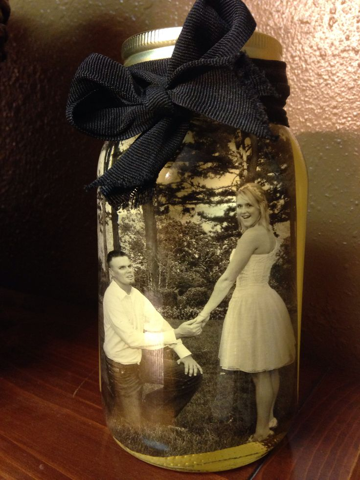 DIY Mason Jar Picture: All you need is a jar, picture, and vegetable oil. Cut your picture to fit your jar, fill with oil, and decorate the jar however you like. (The oil preserves the photo and gives it a vintage look)!