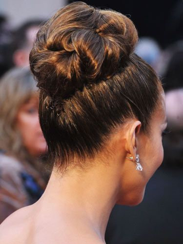 This classic updo has just the right amount of texture to hold that veil. #JenniferLopez #WeddingHair