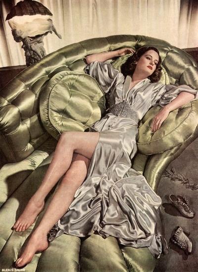 Alexis Smith 1940's  Love that sofa.