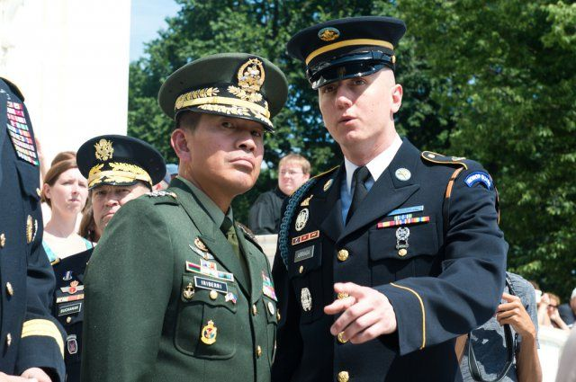 3rd Infantry Regiment's Spc. John M. Arriaga briefs Philippine Army Commanding General Lt. Gen. Hernando Iriberri on the Changing of the Guard at the Tomb of the Unknown Soldier in Arlington National Cemetery, VA, June 30, 2014. Lt. Gen. Iriberri...