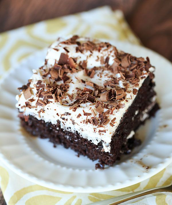 Mudslide Poke Cake - Chocolate cake infused with sweetened condensed milk, hot fudge, vodka, Kahlua and Baileys Irish Cream. An easy, delicious cake with a nice kick! | browneyedbaker.com