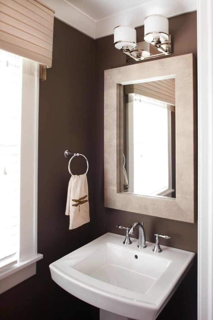 shades bathroom furniture uk%0A Deep brown walls are complemented by neutral decor and chrome fixtures in  this powder room