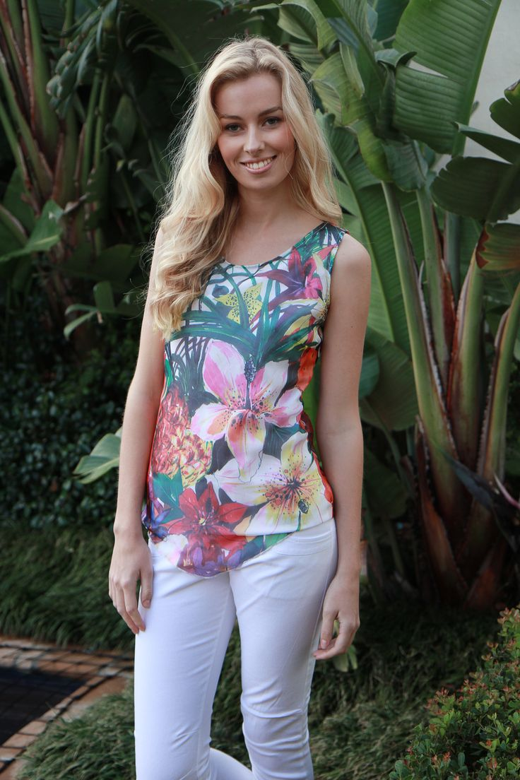 Work florals into summer with Island Lily's Paradise silk vest Top.  Inspired by summer, the colourful print is based in white, so it looks crisp and breezy with any palette