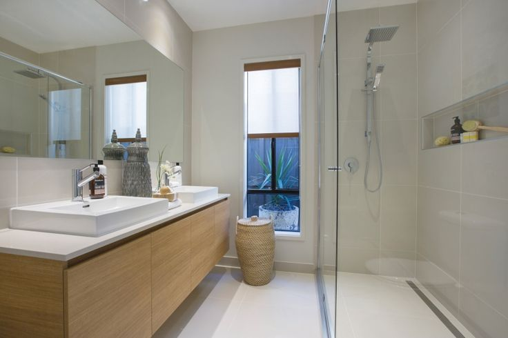 In a small space the styling of this bathroom is kept light and bright with natural timbers and rattan furnishings.