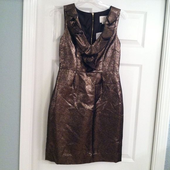 """Kate Spade sparkle cocktail dress Kate Spade cocktail dress lands 3 inches above the knee (I'm 5'7"""") and has flattering modified tulip skirt. Cloth is mostly black with a copper sparkly thread. V-neck has small ruffles. Please note: when posted it was NWT, now is NWOT (ended up not wearing to an event is favor of another option). kate spade Dresses"""