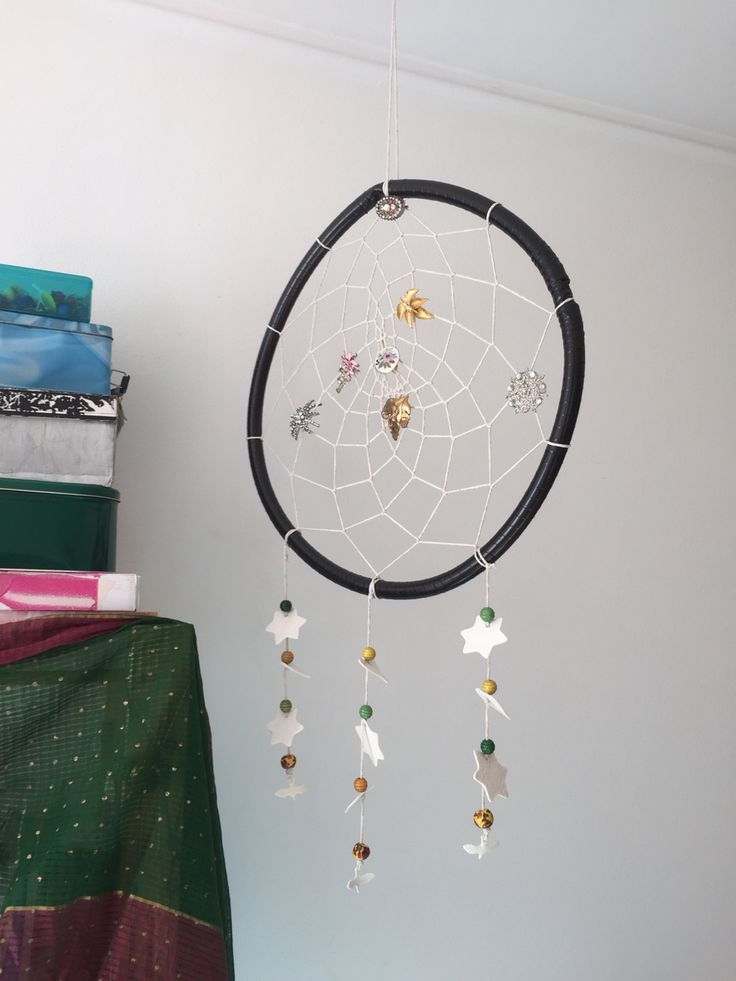 Dreamcatcher with brooch and ceramic ornaments