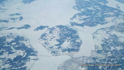 View of a airport on a island surrounded by rivers of ice over Norway.  http://www.7SeasVacation.com