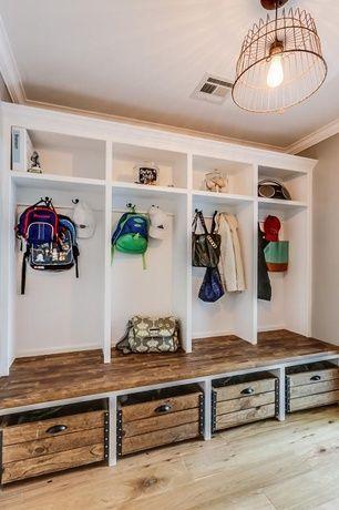 Rustic Mud Room with Pendant light, Built-in bookshelf, Crown molding, Hardwood floors