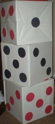 Large dice from boxes & wrapping paper. I'd place the seams on the tops & bottoms, where they won't show. Cheap decor, if you can find boxes that are square.