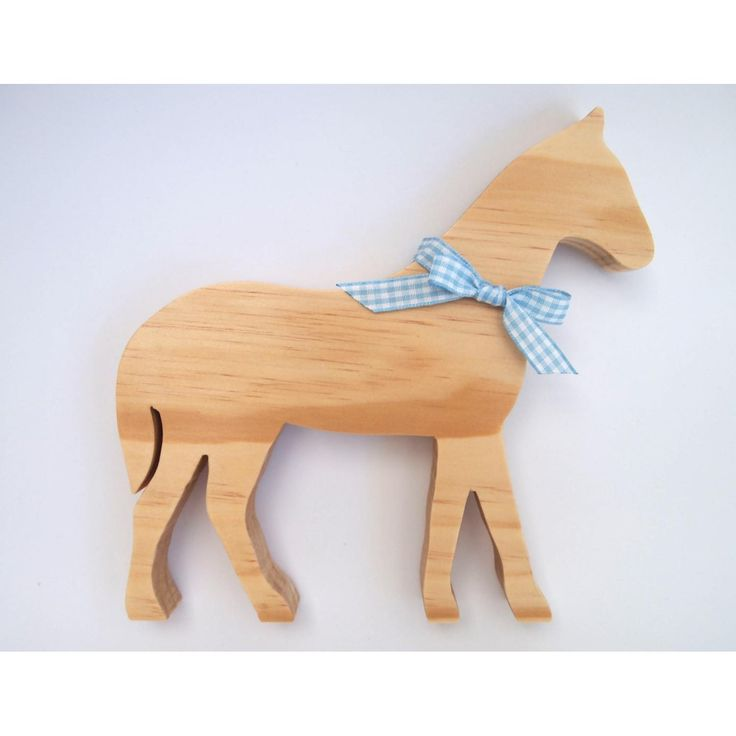 Simpledecorative wooden Horse.A lovely gift idea or addition to any room of the house.Handmade from premium quality, sustainably sourced timber and finished in a clear matte varnish and ribbon.Horse will stand up on its own.Measurements: Height 180mm, Length 180mm, Width 18mmOther ribbon colours and stylesavailable. Due to natural variations in the grain of timber, your item may differ slightly from the picture. If you have any concerns please contact us.This item is for decorative…