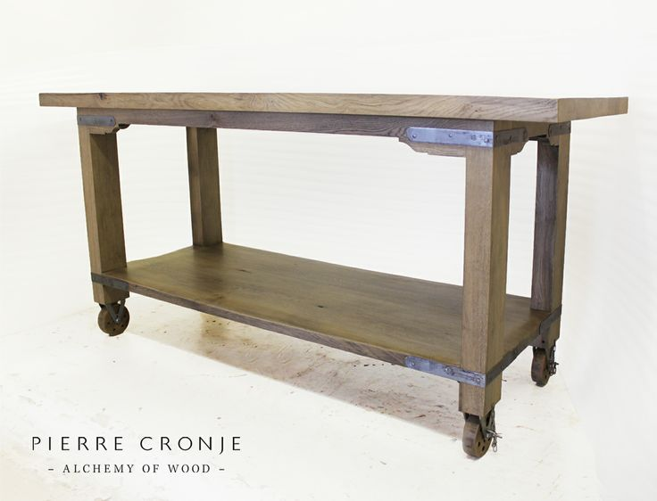We love this mobile bar unit, custom made by Pierre Cronje in French Oak with pewtered iron hardware.  It would be perfect as a kitchen island too!