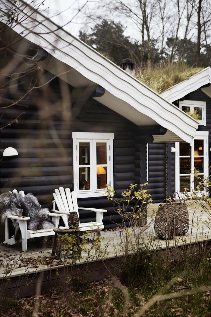 black stained log cabin with great deck