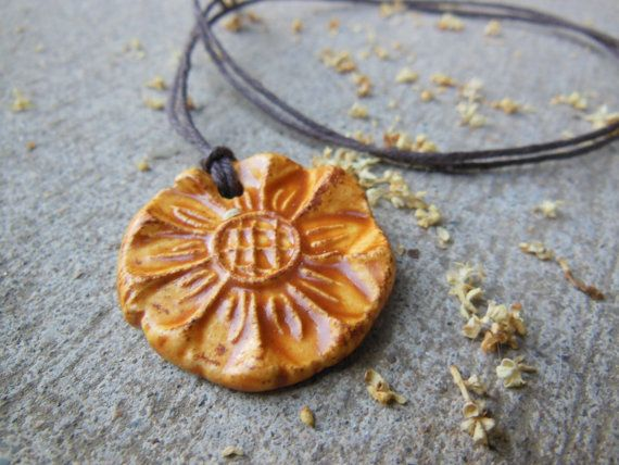 Made with a handmade stamp for one of a kind look. Rustic Sunflower Textured Essential Oil Diffuser Necklace, Natural Medicine Ceramic Pendant Aromatherapy Floral Jewelry
