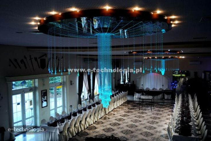 Chandeliers for the wedding hall are a common solution to decorate the interior. Normal lighting in a wedding hall is no longer sufficient to excite admiration. One proven solution is fiber optic chandelier Octopus with ceiling clamping of the starry sky. This solution greatly stand out rooms to other for years. The whole project and the effects of light can be seen in the photos below.  www.e-technologia.pl