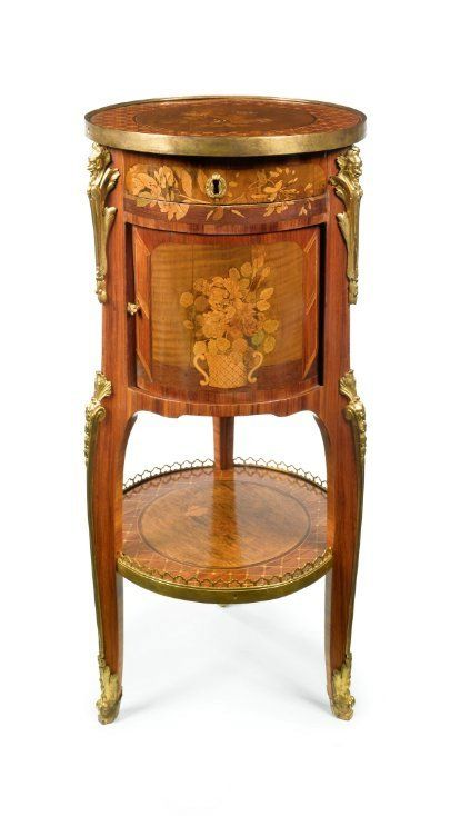 A LOUIS XV/XVI TRANSITIONAL ORMOLU-MOUNTED TULIPWOOD, FRUITWOOD AND MARQUETRY TABLE EN CHIFFONNIÈRE ca 1765, stamped J.L. Cosson JME Jacques Laurent Cosson (1737-1812), maître in 1765 height 30 1/4 in.; diameter 13 3/4 in. / 77 cm; 35 cm
