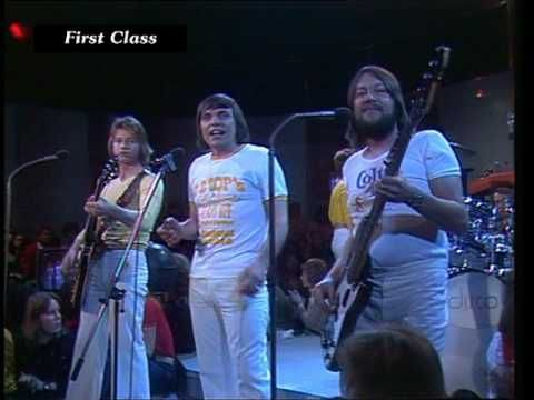 HQ-Video. First Class - Beach Baby, a hit in 1974. The song was produced with singer Tony Burrows, but he didn't perform on TV. Check out wikipedia for more information: http://en.wikipedia.org/wiki/The_First_Class
