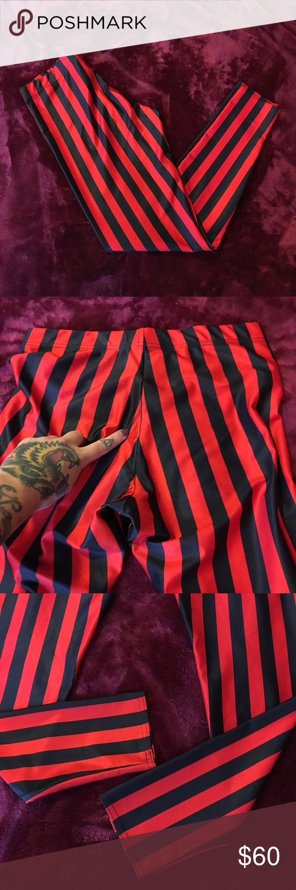 BlackMilk Clothing Red & Black Beetlejuice Legs L Bought these from another sharkie, in this exact condition. I've worn a few times, absolutely obsessed with them but they're too big now. Pictures of the seam stretch posted, but no other signs of wear. Size L, hard to find!! Blackmilk Pants Leggings