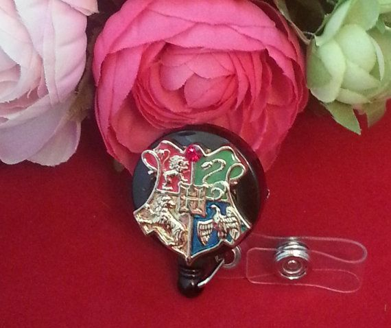 Must have :) https://www.etsy.com/listing/167392130/hogwarts-school-crest-id-reel