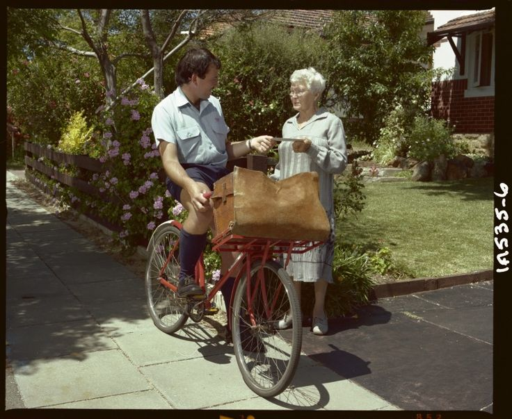 320160PD: Postman on bicycle delivering mail to a lady, 1982. https://encore.slwa.wa.gov.au/iii/encore/record/C__Rb2454664