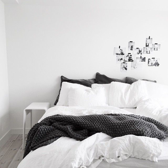 bedroom: monochrome with taped art