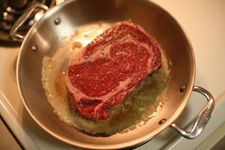 pan-fry the ribeye in butter
