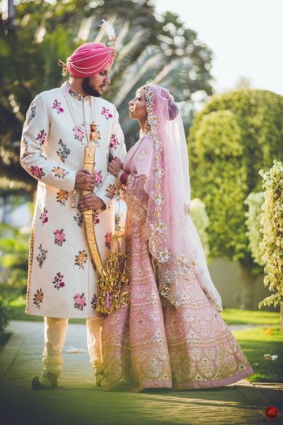 Candid Couple Shot - Bride in a Pink Heavy Lehenga with the Groom in   a White and Floral Sherwani | WedMeGood Shot by: Artcapture Productions #wedmegood #indianbride #indianwedding #bridal #coupleshot #candid #pink #gold #sikhwedding #sikhweddingcouple