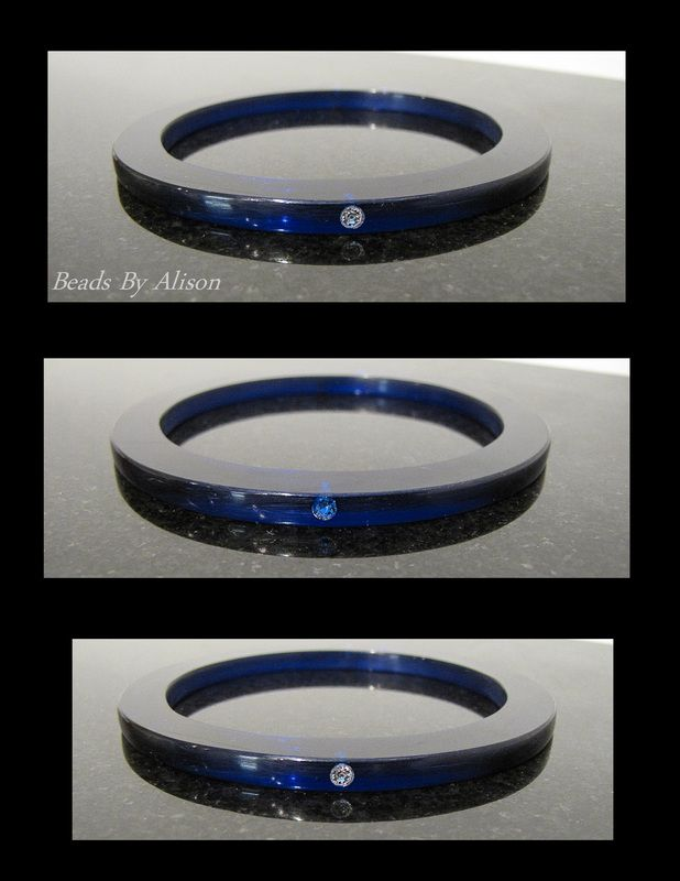 Sapphire Blue perspex bangle with diamond white & sapphire blue rhinestones set at North & South positions. The Bangle & Bracelet Collection - Beads By Alison