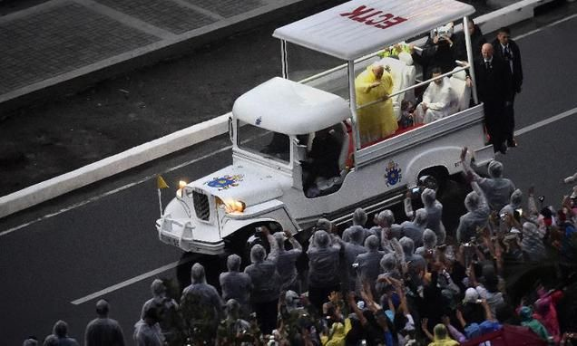 """Francis thrills in Philippines with 'jeepney' popemobile Pope Francis made a triumphant entrance for a mass with millions in the Philippines on Sunday aboard a """"popemobile"""" styled after the nation's iconic, flamboy..."""